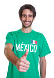 Mexican sports fan with beard showing thumb up Royalty Free Stock Photos