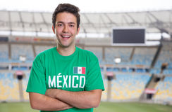 Mexican sports fan at soccer stadium. Mexican sports fan in sports jersey of the national team at soccer stadium Stock Image