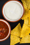 Mexican street food nachos  with salsa and cream dip Royalty Free Stock Photos