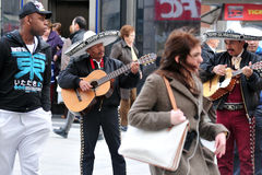 Mexican street musician plays guitar in Madrid Spain. MADRID - MAR 02: An unidentified Mexican street musician plays guitar on March 02, 2010 in The Puerta del Stock Image