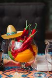 Mexican style decoration in a restaurant. Served table. Empty glasses Royalty Free Stock Photos