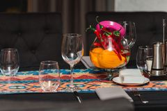 Mexican style decoration in a restaurant. Served table. Empty glasses stock photo