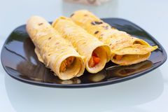 Mexican style enchiladas. On the plate Royalty Free Stock Photos