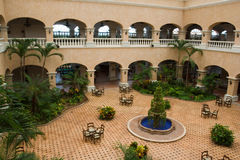 Mexican style hotel lobby. And patio area with fountain and tables Royalty Free Stock Photography