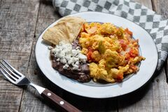 Free Mexican Style Scrambled Eggs With Fried Beans, Cheese And Jalapeno Stock Photography - 182508162