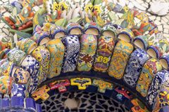 Mexican style talavera crafts. Mexican talavera style pottery used in altar and fountain. This colorful handmade maiolica have a blurred appearance as they fuse royalty free stock photography