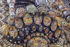 Mexican style talavera crafts. Mexican talavera style pottery used in altar and fountain. This colorful handmade maiolica have a blurred appearance as they fuse stock image