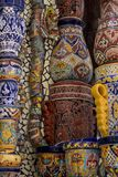 Mexican style talavera crafts. Mexican talavera style pottery used in altar and fountain. This colorful handmade maiolica have a blurred appearance as they fuse stock photo