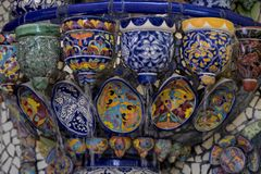 Mexican style talavera crafts. Mexican talavera style pottery used in altar and fountain. This colorful handmade maiolica have a blurred appearance as they fuse stock photos