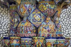 Mexican style talavera crafts. Mexican talavera style pottery used in altar and fountain. This colorful handmade maiolica have a blurred appearance as they fuse royalty free stock photo