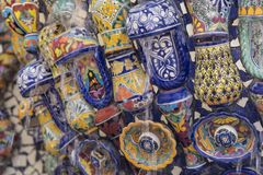 Mexican style talavera crafts. Mexican talavera style pottery used in altar and fountain. This colorful handmade maiolica have a blurred appearance as they fuse royalty free stock image
