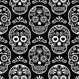 Mexican sugar skull  seamless pattern on black, Halloween white candy skulls background, Day of the Dead celebration, Calave Stock Photos