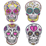 Mexican sugar skull set. Mexican skull set. Colorful skulls with flower and heart ornamens. Sugar skulls Stock Photo