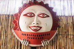 Mexican sun eating a watermelon, ceramic colorful sun stock images