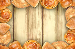 Mexican sweet bread. Sweet bread assorted traditional Mexican bakery frame with wood in background Royalty Free Stock Image