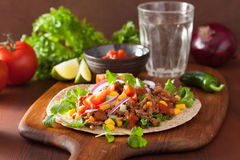 Mexican taco with beef tomato salsa onion corn Royalty Free Stock Photo