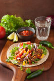 Mexican taco with beef tomato salsa onion corn Stock Photos