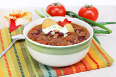 Mexican Taco Soup. One bowl of Mexican Taco Soup, garnished with sour cream, scallions and vegetable chips stock photo