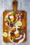 Mexican tacos with avocado, slow cooked meat, grilled corn, red cabbage slaw and chili salsa on rustic stone table. royalty free stock photography