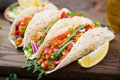 Mexican tacos with beef, beans in tomato sauce. And salsa Stock Images