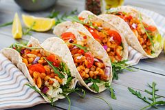 Mexican tacos with beef, beans in tomato sauce. And salsa Stock Photos