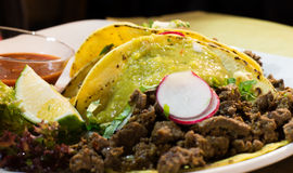 Mexican tacos with beef, onion and vegetables. On a mexican restaurant Royalty Free Stock Image