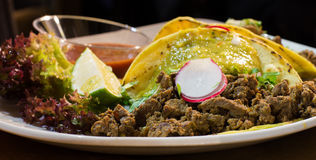 Mexican tacos with beef, onion and vegetables. On a mexican restaurant Royalty Free Stock Photography