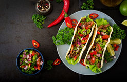 Mexican tacos with beef. In tomato sauce and salsa Royalty Free Stock Photo