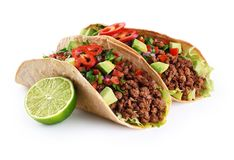 Mexican tacos with beef, tomatoes, avocado, chilli and onions. Isolated on white background. With clipping path royalty free stock image