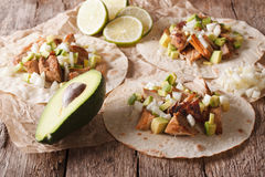 Mexican tacos with carnitas, onions and avocado close-up. horizo Royalty Free Stock Photo