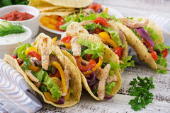 Mexican tacos with chicken, black beans and fresh vegetables Stock Photos