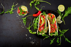 Mexican tacos with chicken fillet in tomato sauce and salsa Stock Images