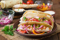 Mexican tacos with chicken, grilled vegetables. Royalty Free Stock Photo