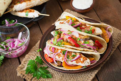 Mexican tacos with chicken, grilled vegetables. Royalty Free Stock Images