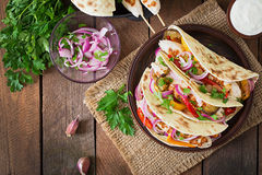 Mexican tacos with chicken, grilled vegetables. Top view Stock Photos