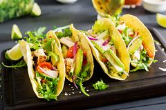 Mexican tacos with chicken meat, avocado, tomato, cucumber and red onion. Healthy tortilla. Wrap food. Taco royalty free stock images