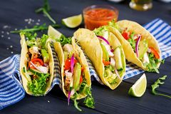 Mexican tacos with chicken meat, avocado, tomato, cucumber and red onion. Healthy tortilla. Wrap food. Taco stock photo