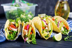 Mexican tacos with chicken meat, avocado, tomato, cucumber and red onion. Healthy tortilla. Wrap food. Taco royalty free stock photography