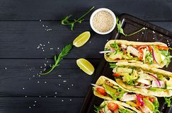 Mexican tacos with chicken meat, avocado, tomato, cucumber and red onion. Healthy tortilla. Wrap food. Taco. Top view royalty free stock photos