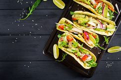 Mexican tacos with chicken meat, avocado, tomato, cucumber and red onion. Healthy tortilla. Wrap food. Taco. Top view stock photos