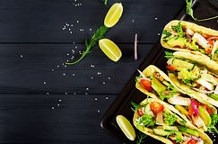 Mexican tacos with chicken meat, avocado, tomato, cucumber and red onion. Healthy tortilla. Wrap food. Taco. Top view royalty free stock image