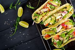 Mexican tacos with chicken meat, avocado, tomato, cucumber and red onion. Healthy tortilla. Wrap food. Taco. Top view stock photography