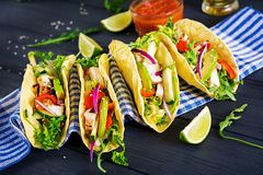 Mexican tacos with chicken meat, avocado, tomato, cucumber and red onion. Healthy tortilla. Wrap food. Taco royalty free stock photo