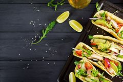 Mexican tacos with chicken meat, avocado, tomato, cucumber and red onion. Healthy tortilla. Wrap food. Taco. Top view stock photo