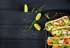 Mexican tacos with chicken meat, avocado, tomato, cucumber and red onion. Healthy tortilla. Wrap food. Taco. Top view royalty free stock images