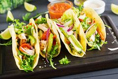 Mexican tacos with chicken meat, avocado, tomato, cucumber and red onion. Healthy tortilla. Wrap food. Taco stock photography