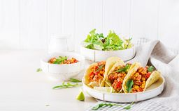 Mexican tacos with chicken meat, corn and tomato sauce. Latin American cuisine. Taco, tortilla, wrap royalty free stock images