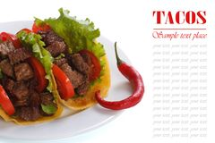 Mexican tacos with chili peppers isolated on white Royalty Free Stock Photo