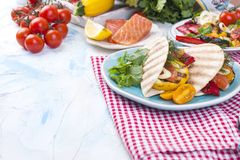 Mexican tacos with grilled vegetables and salmon. Healthy food for lunch. Fast food. Copy space.  Stock Photography