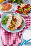 Mexican tacos with grilled vegetables and salmon. Healthy food for lunch. Fast food. Copy space.  Royalty Free Stock Photography